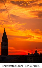 View of the Campanillus of the Cathedral of St. Mark in Venice at sunset.