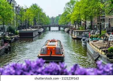 View of a canal in Amsterdam with boats. Netherlands