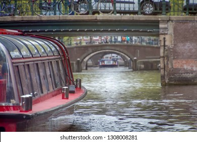 View of canal in Amsterdam from the side of cruise boat, Looking through under bridge, Amsterdam canal tours is very famous activities, Tourist attraction, Netherlands.