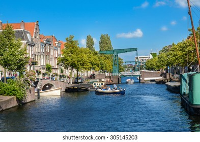 A view at a canal with boats in Leiden