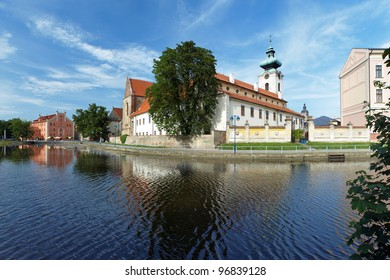 View from canal to the Church of Presentation of Virgin Mary (backside) and Dominican Convent in Ceske Budejovice, Czech Republic