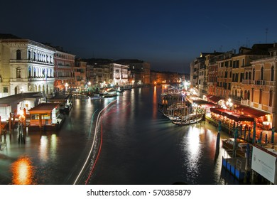 view of canal grande and blurry boat lights at night. Italy-Venice 29 January 2017