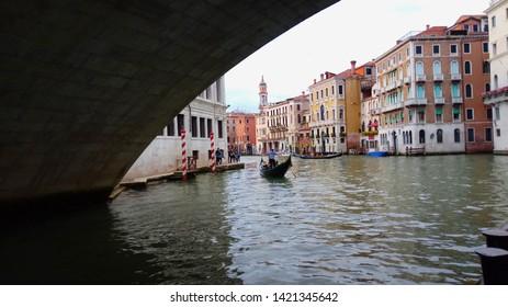 View of Canal Grande with a gondolier under Rialto bridge