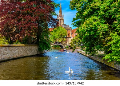 View of canal in the historic city center of Bruges (Brugge), West Flanders province, Belgium. Cityscape of Bruges.