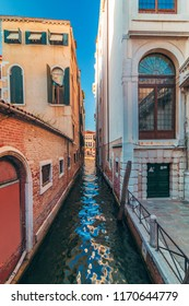 View of canal in Venice and street with beautiful colorful old houses