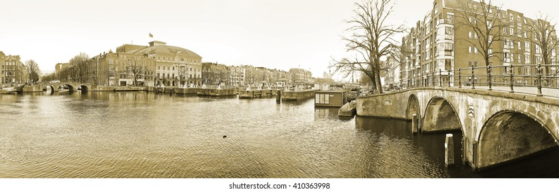 View of the canals with bridge and typical Dutch houses in Amsterdam, Netherlands.