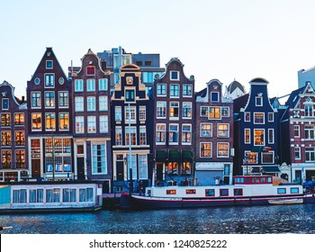 View of the canals with houseboats in Amsterdam. Netherlands.