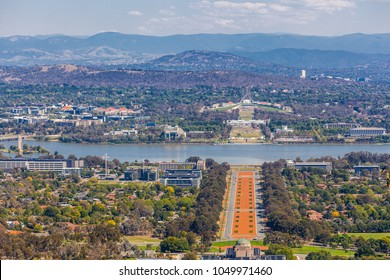View of Canberra  from Mount Ainslie lookout - ANZAC Parade, Parliament House and modern architecture with mountains in background. ACT, Australia