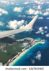 View of Cancun and airplane wing taken with a smartphone