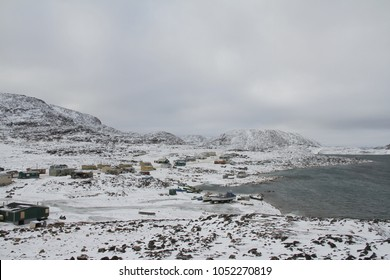 View of Cape Dorset Nunavut with a view of the mountains and ocean, a northern Inuit community in arctic Canada