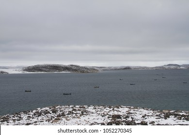 View of Cape Dorset Nunavut with a view of the ocean and boats, a northern Inuit community in arctic Canada