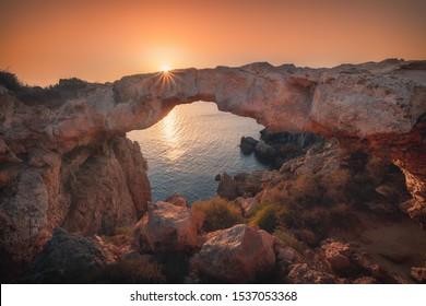 View of Cape Greco and Kamara Tou Koraka natural arch bridge, Protaras, Ayia Napa, Cyprus