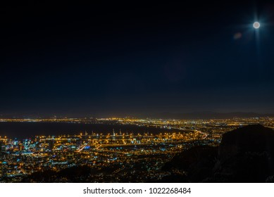 View of Cape Town and its harbour in summer from Table Mountain during the super moon