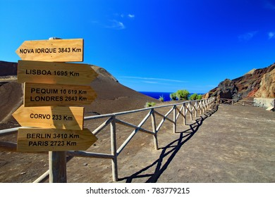 view of Capelinhos volcano with signpost on the island of Faial in the Azores