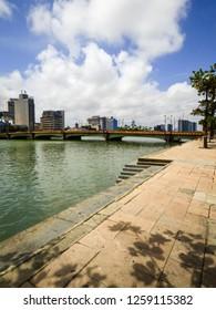 A view of Capibaribe river with Mauricio de Nassau bridge and cityscape in the background - Recife, Brazil