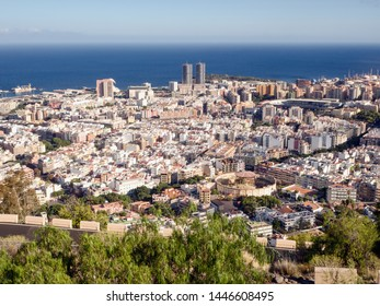 View of the capital Santa Cruz de Tenerife from the Mirador de los Campitos in the evening sun and with blue sky and very blue Atlantik.Directly in front of the dark blue Atlantic are the twin towers,