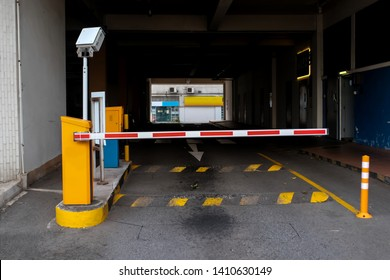 View of a car barrier gate at the entrance to an apartment