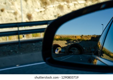 view in the car mirror on fast road in the Spain, beautiful landscape, transportation