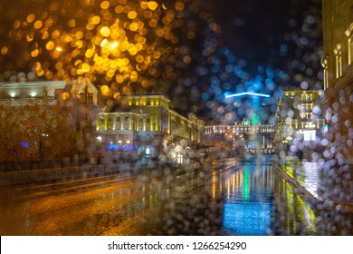 View from the car. Raindrops on the glass. Evening in the city. September 9, 2018, Norilsk