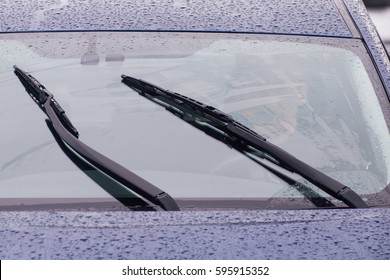 view of the car windshield wipers in the rain
