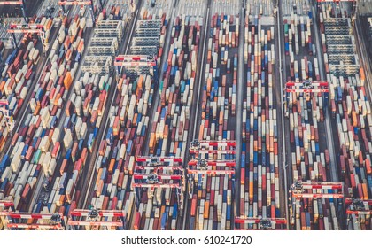 view of cargo shipping containers stacked on docks.