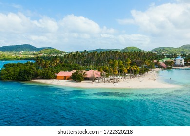 View of the Caribbean island of Martinique French Polynesia. The coast of Martinique with turquoise water, palm trees and a gorgeous beach.