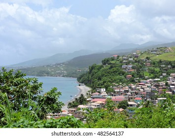 View to the Caribbean mountains landscape: Dominica village on the west coast of the island and the Caribbean sea.
