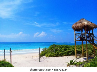View of the Caribbean sea with lookout tower in Xcacel Beach, Riviera Maya, Mexico