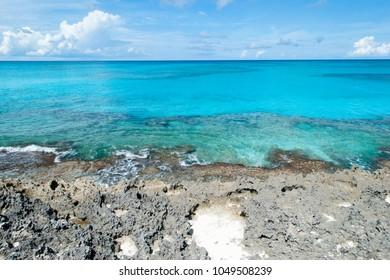 The view of Caribbean Sea and rocky beach on uninhabited island Half Moon Cay (Bahamas).