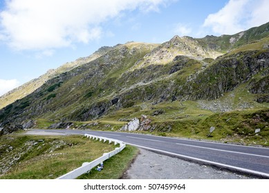 View to the carpathian mountains war road transfagarasan from the top with lonely trees and clouds above