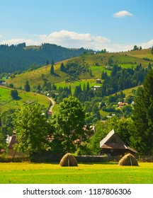View of Carpathians mountains village in the hot summer day. Ukraine