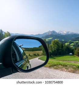 View from the car's mirror in mountain road