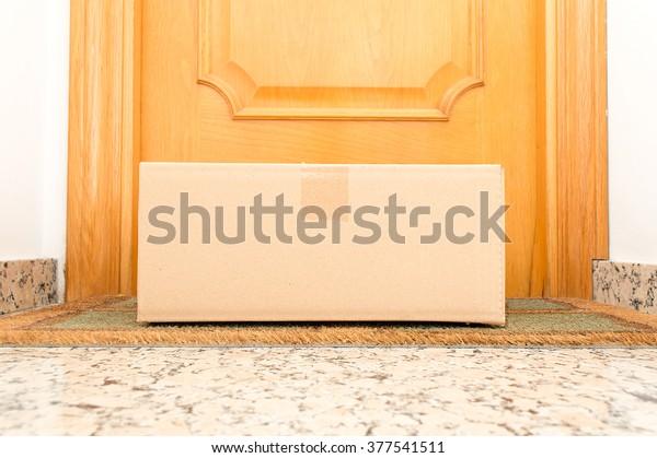 view of carton box on the floor of doorway home