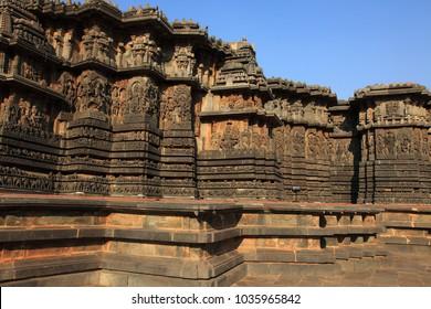 View of the carving rich stone walls of ancient Hoysaleswara temple in Halebidu, Karnataka, India