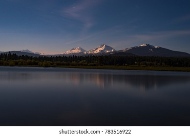 View of the Cascade Mountains from Black Butte Ranch at Night with Star Trails and Reflections in the Lake