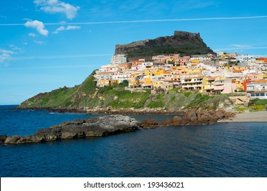 View of Castelsardo fortress and village from the beach, Sardinia, Italy