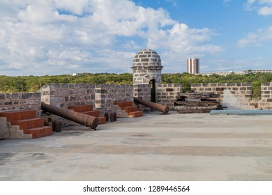 View of Castillo de Jagua castle, Cuba. Ciudad Nuclear (Nuclear City) in the background.