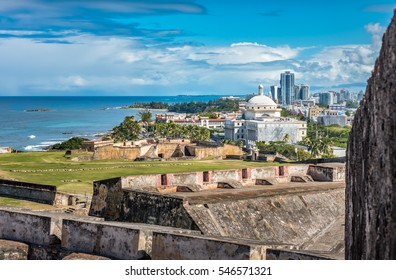 View from Castillo de San Cristobal toward town with view of the Capitol building and ocean front