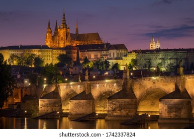 View of the castle and Charles bridge in Prague after the sunset