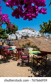 View of the castle and city of Astypalaia from a colorful cafe. Astypalaia is an aegean island of Greece.