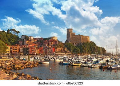 View of castle of Lerici and gulf of Lerici. Colorful building on harbour. Beautiful small city Lerici, Italy, Liguria. Poet's bay at sunset.
