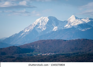 View from castle Ljubljana over small village Rasica to mountain range Kamnik–Savinja Alps with summits Kocna and Grintovec in Slowenia, Europe