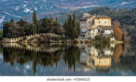 view of the castle on the shores of Lake Toblino, Trentino Alto Adige, Italy