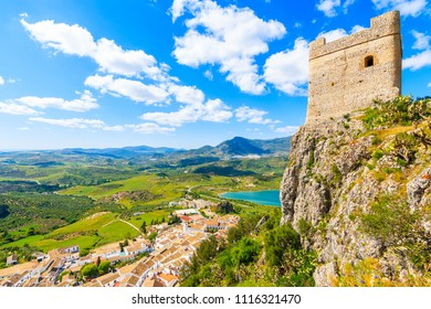 View of castle tower and Zahara de la Sierra village in spring season on sunny beautiful day, Andalusia, Spain