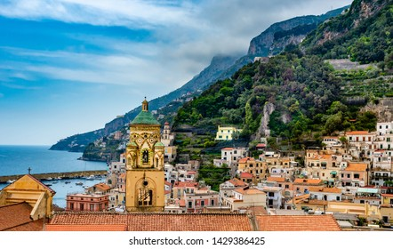 View of cathedral and colorful buildings in  Amalfi town at Amalfi coast, Italy.