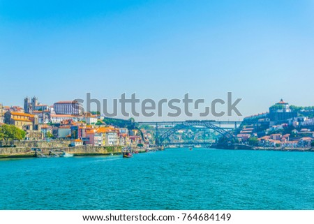 View of the cathedral, episcopal palace, luis I bridge and colorful houses in Porto, Portugal.