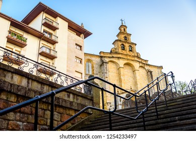 The view of the cathedral in Guernica in Basque country. Urbanistic landscape of the old Spanish city. The staircase leading to Cathedral in Guernica. The view of the house in Guernica.
