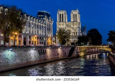 View of Cathedral Notre Dame de Paris at night - a most famous Gothic, Roman Catholic cathedral (1163 - 1345) on the eastern half of the Cite Island.