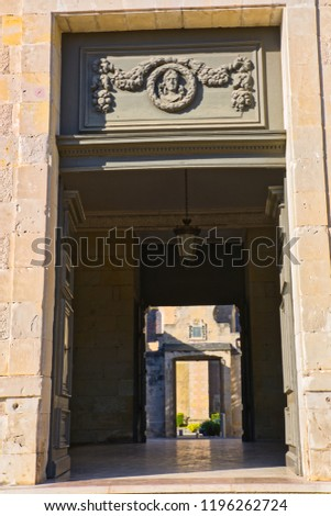 View of cathedral through the doors of the Bishop's palace (now the town hall) in Castres, Southern France