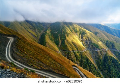 View in the Caucasus Mountains in the clouds. Dangerous road to Omalo in Tusheti region. Georgia